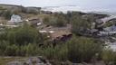 Ogromni plaz v morje odnesel več hiš #video