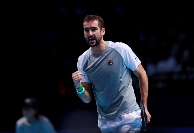 Marin Cilic was celebrated by John Isner.