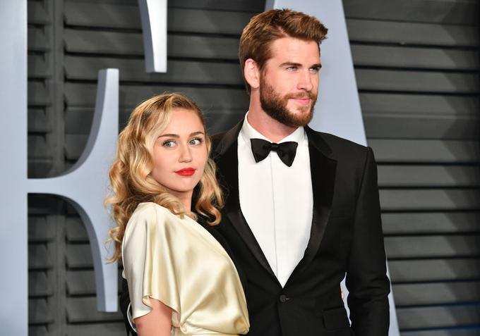 Miley Cyrus in Liam Hemsworth.