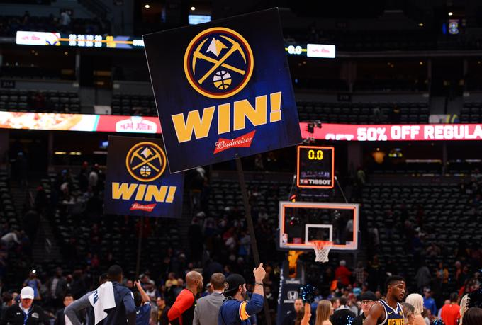 Denver Nuggets basketball players placed themselves above Atlanta.